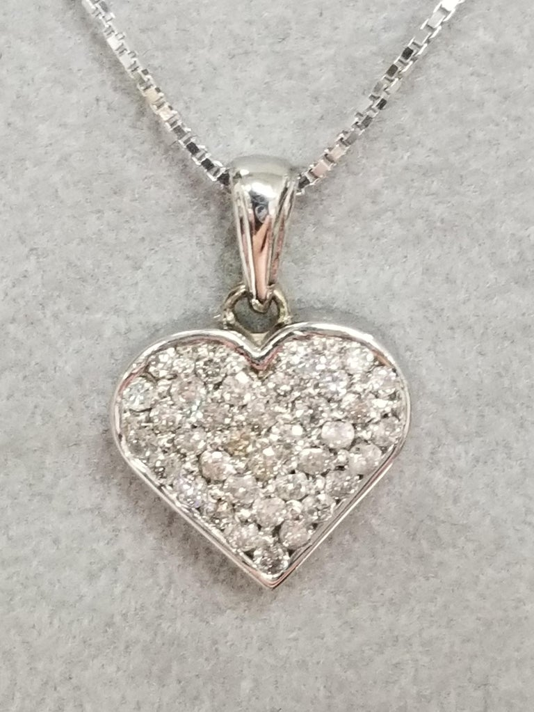 14k white gold diamond heart containing 36 round full cut diamonds weighing .65pts. on a 16 inch box chain.