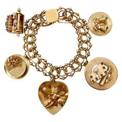 14k Gold 1950s Eclectic Charm Bracelet