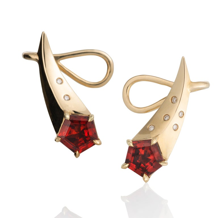 Made in 14ky with diamonds, these are perfect little ear climber earrings, designed for daily wear.  They are small, shooting stars with fancy cut, 5mm Madeira Garnet and ten tiny diamonds lighting up the tail of the comet.  The earrings are made