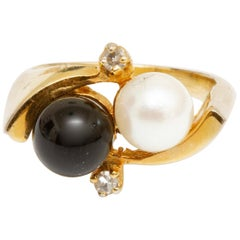 14 Karat Gold Cultured Pearl, Black Onyx and Diamond Ring