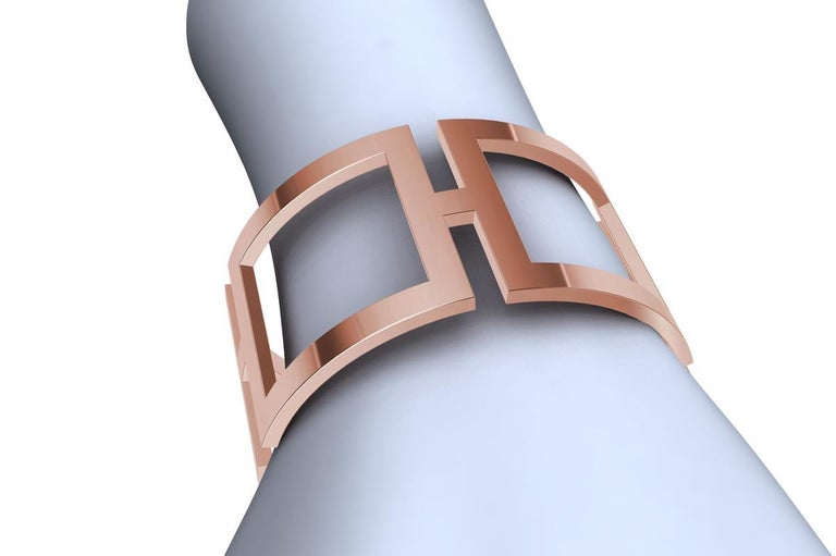 14K Pink Gold Rectangle Cuff Bracelet , 4 x 2 mm thick x  mm 31 .25 wide. This is one of my early designs.  I was using the simple rectangle in a curved state for the ultimate in expression of sculpture and a piece of jewelry. Clean, simple and
