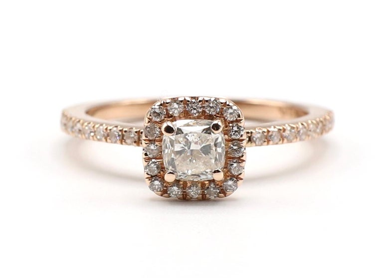 Vintage 14K Rose / Pink Gold 1/2 carat Diamond Cushion Halo Engagement Ring Size 6.25  Metal: 14K rose gold Weight: 2.79 grams Diamonds: 1 cushion cut diamond, approx. .50 cts, H SI, 39 small round diamonds on the band and halo, approx. .25 CTW G