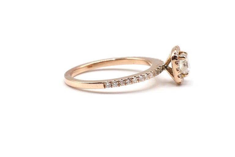 Contemporary 14 Karat Rose Gold 1/2 Carat Cushion Diamond Halo Engagement Ring For Sale