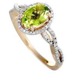 14 Karat Rose Gold Diamond and Peridot Oval Ring