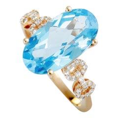14 Karat Rose Gold Diamond and Topaz Oval Ring