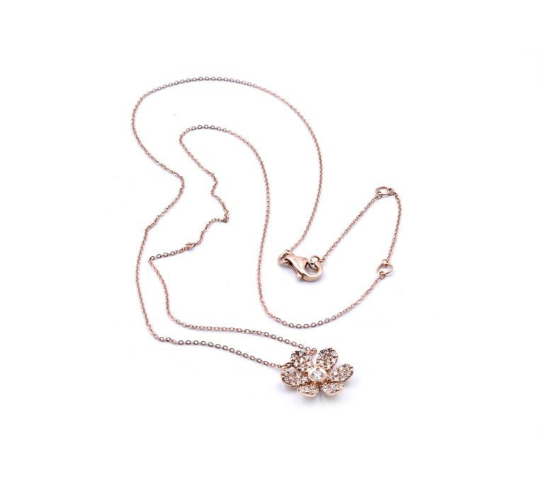 Round Cut 14 Karat Rose Gold Diamond Flower Necklace For Sale