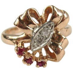 14 Karat Rose Gold Ruby and Diamond Bow Cocktail Ring, 1940s