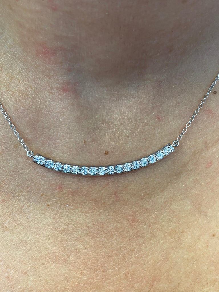 Diamond bar pendant set in 14K white gold. The pendant is set with 16 stones each weighing 0.07 carats. The total diamond weight is 1.12 carats. The stones are G-H, SI clarity. The total length is 16 inches.