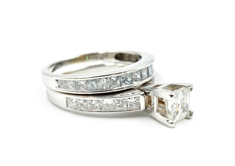Designer: custom Material: 14k white gold Center Diamond: 1 princess cut = 1.00ct Color: I Clarity: I1 Mounting Diamonds: 12 princess cut= 0.72cttw Color: G-H Clarity: SI Ring Size: 7 (please allow two additional shipping days for sizing
