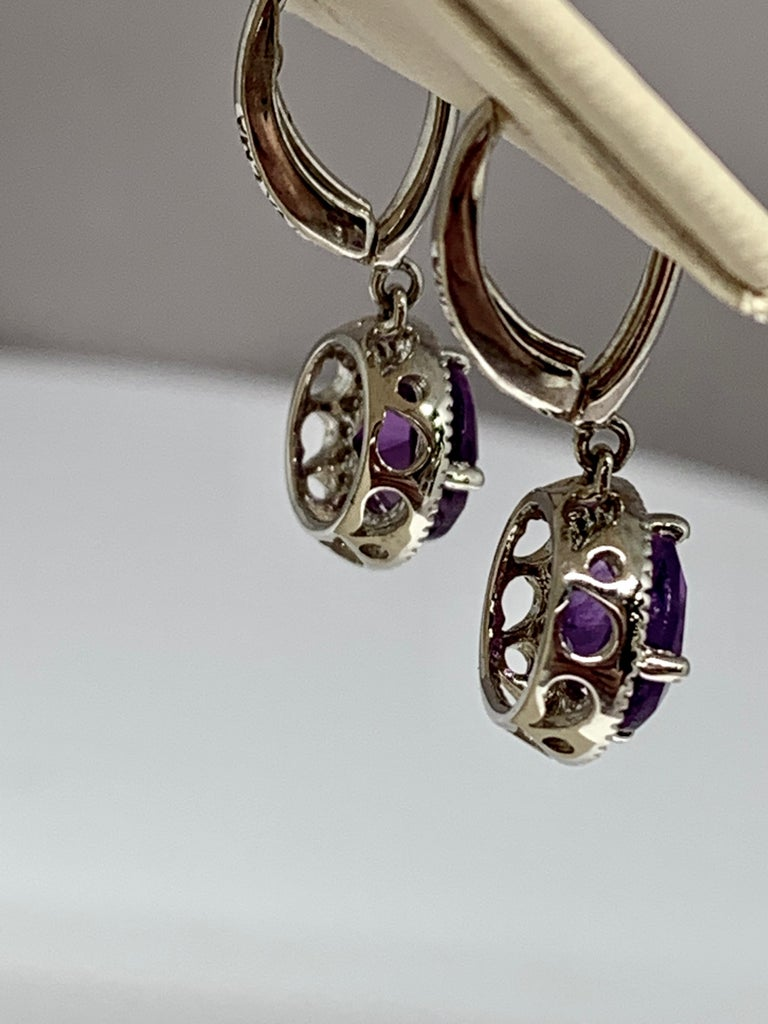 Round Cut 14 Karat White Gold 2.24 Carat Total Weight Amethyst and Diamond Drop Earrings For Sale