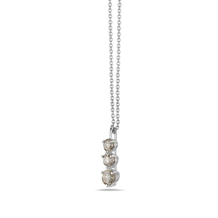 This pendant features 3 graduated round diamonds set in 14K gold. Made in USA.