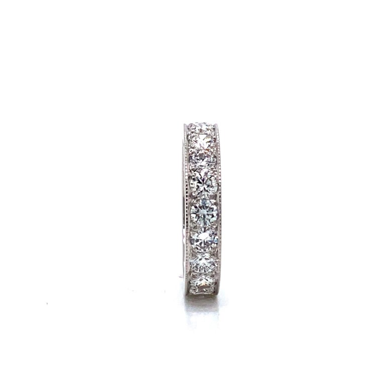 14k White Gold and 2cttw Diamond Eternity Band Ring Size 5.75  Condition:  Excellent Condition, Professionally Cleaned and Polished Metal:  14k Gold (Marked, and Professionally Tested) Weight:  5g Diamonds:  Round Brilliant Diamonds 2cttw (Each