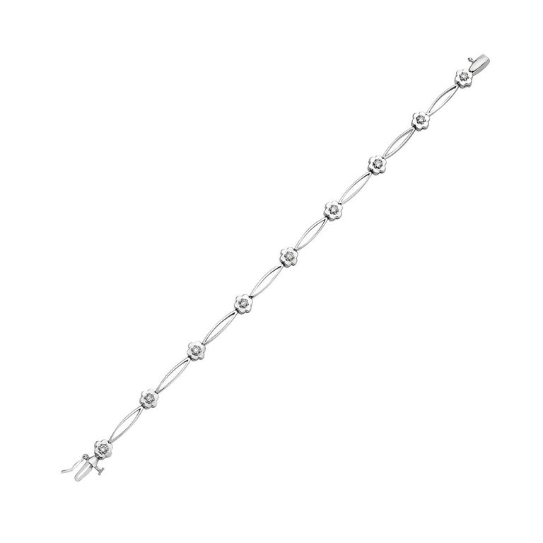 This bracelet features 0.35 carats of round diamonds set in 14K white gold. 7.5 inch length. 8.3 grams total weight.    Viewings available in our NYC showroom by appointment.