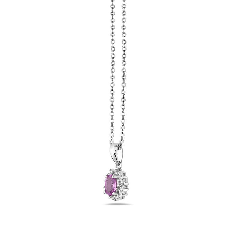 This pendant necklace features pink sapphires and diamonds set in 14K white gold. Made in USA.  Viewings available in our NYC showroom by appointment.