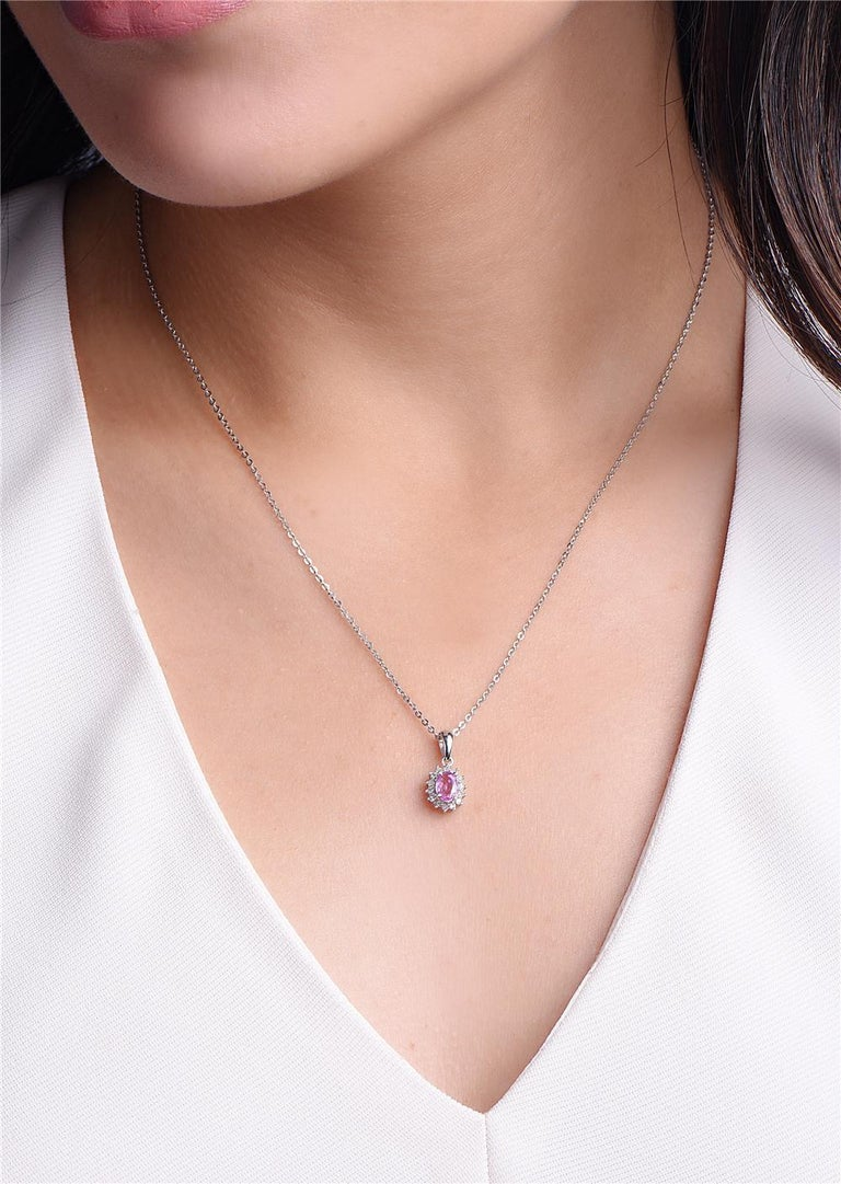 Round Cut 14 Karat White Gold and Pink Sapphire Diamond Pendant Necklace For Sale