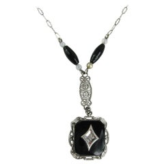 14 Karat White Gold Art Deco Onyx Diamond Pendant Necklace