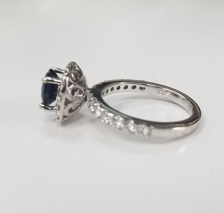 Contemporary 14 Karat White Gold Blue Sapphire and Diamond Halo Ring For Sale