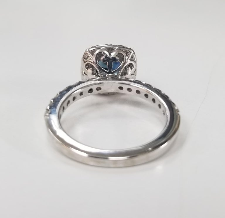 Round Cut 14 Karat White Gold Blue Sapphire and Diamond Halo Ring For Sale