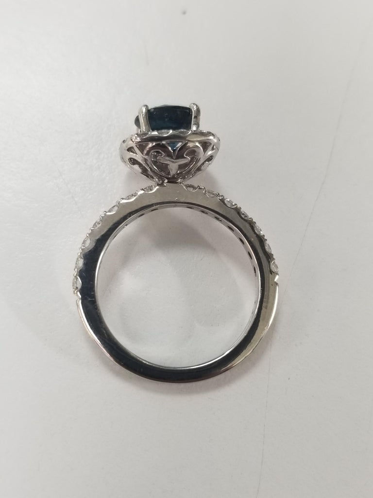 14 Karat White Gold Blue Sapphire and Diamond Halo Ring In New Condition For Sale In Los Angeles, CA