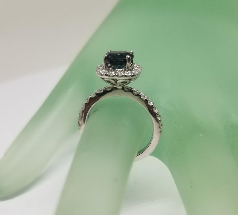 14 Karat White Gold Blue Sapphire and Diamond Halo Ring For Sale 1