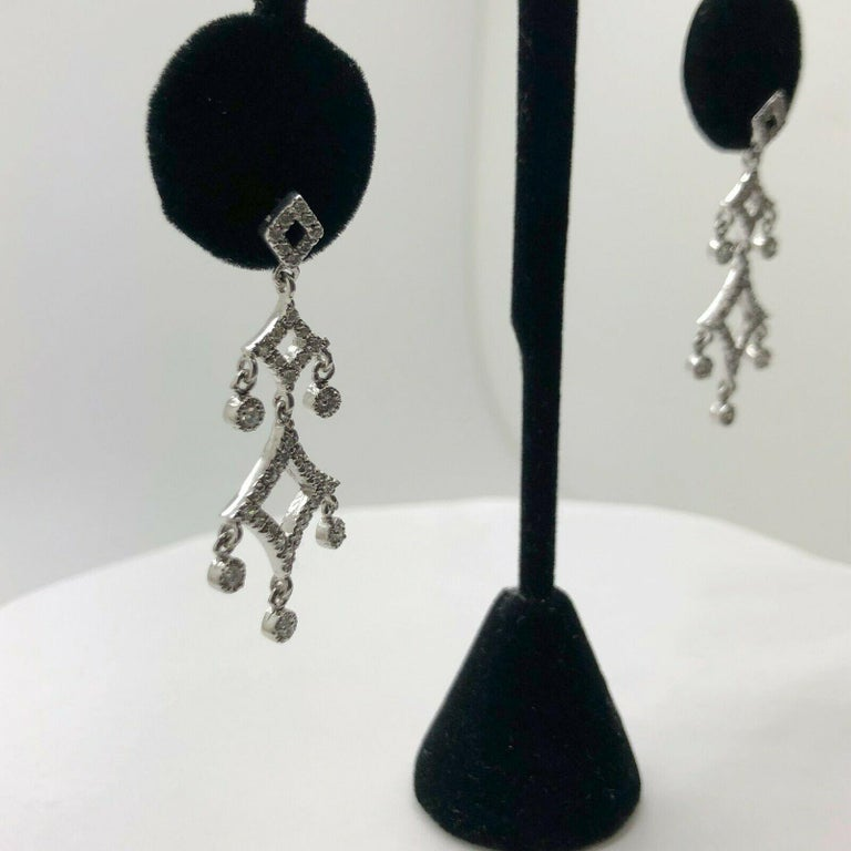 Discover diamond decadence with these dramatic chandelier earrings. at 4cm in length with over 1.04 carat of round brilliant diamonds with a color of F and has a clarity of SI2 set in gleaming 14k white gold, they are a bridal or special occasion