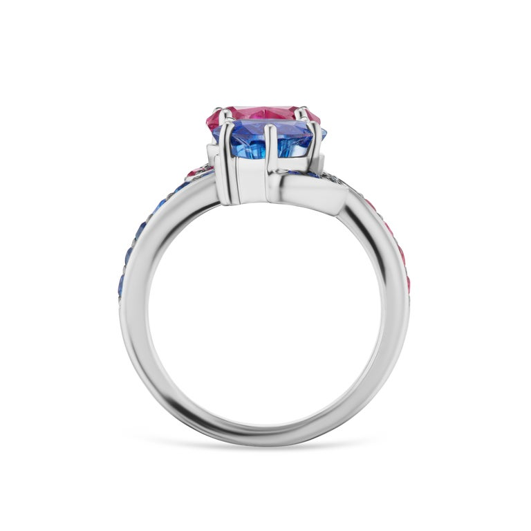 This Contrarie cocktail ring features a 1.77 carat heart shape sapphire and a 1.98 carat ruby with 30 ruby and sapphire side stones.   Resizeable upon request.  Viewings available in our NYC showroom by appointment.
