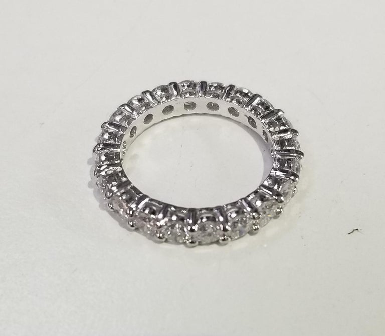 Round Cut 14 Karat White Gold Diamond 2.50 Carat Eternity Ring with Shared Prongs For Sale