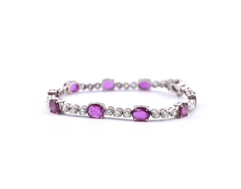Designer: custom design Material: 14k white gold Diamonds: 30 round brilliant cut = 2.10cttw Color: G Clarity: VS Ruby: 10 oval cut = 8.00cttw  Dimensions: bracelet is 7 inches long and it is 13.62mm wide Weight: 14.49 grams