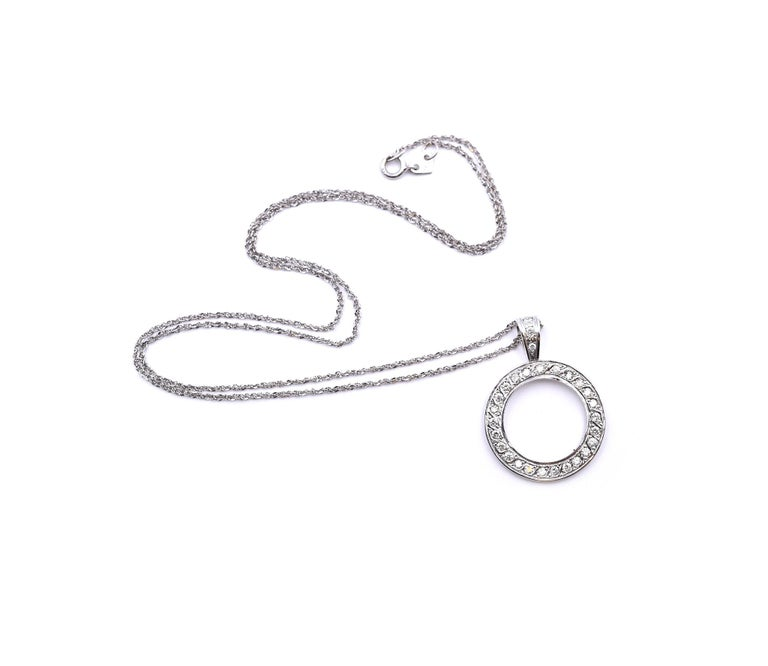 Designer: custom design Material: 18k white gold Diamonds: 25 round brilliant cut= 0.50cttw Color: G Clarity: VS2 Dimensions: necklace is 18-inches long, circle is 20.50mm in diameter, 3.50mm wide  Weight: 4.70 grams