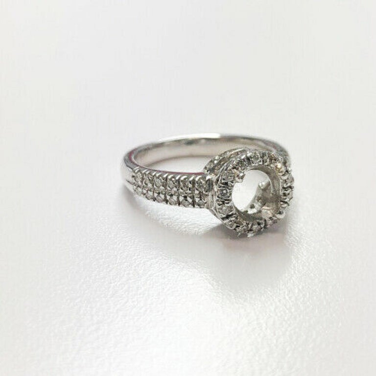 14k white gold diamond halo ring, containing 50 round full cut diamonds weighing .60pts.   Specifications:     type: MOUNTING     metal: WHITE gold     purity: 14k     SIZE: 6.75 US     WIDTH: 3.42 mm     weight: 5.6 gr     SIDE STONES: 50PCS ROUND