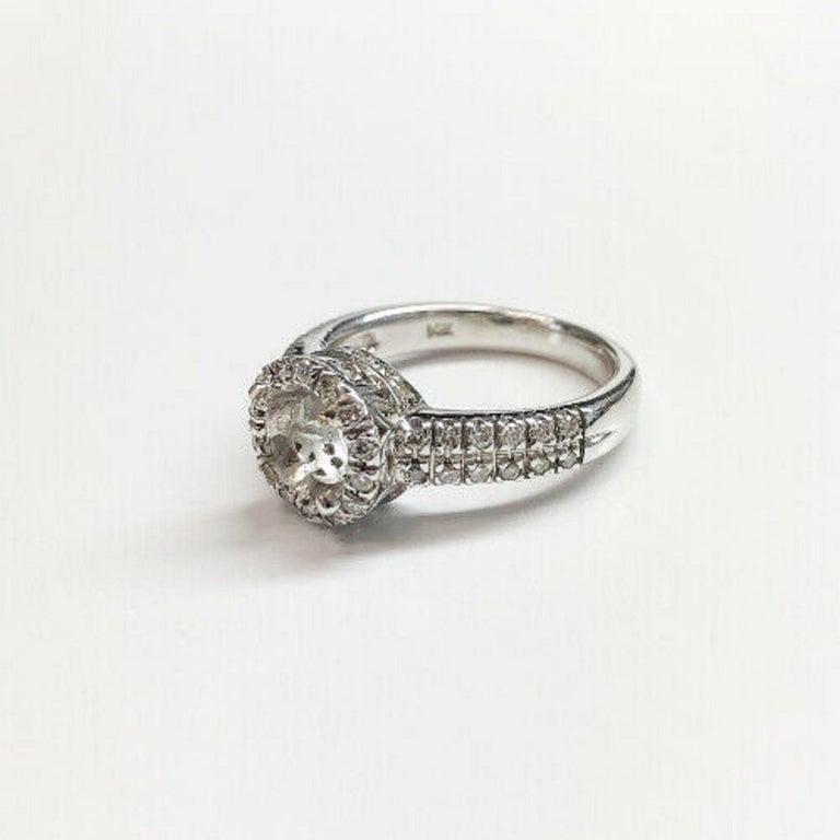 Contemporary 14 Karat White Gold Diamond Halo Ring For Sale