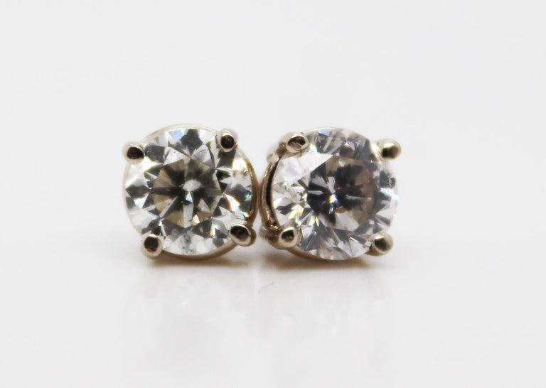 These stunning stud earrings are in 14k white gold and feature breathtaking white diamond centers! The diamonds are almost perfectly matched and big enough for their sparkle to be seen from across the room! These earrings are the diamond staple that