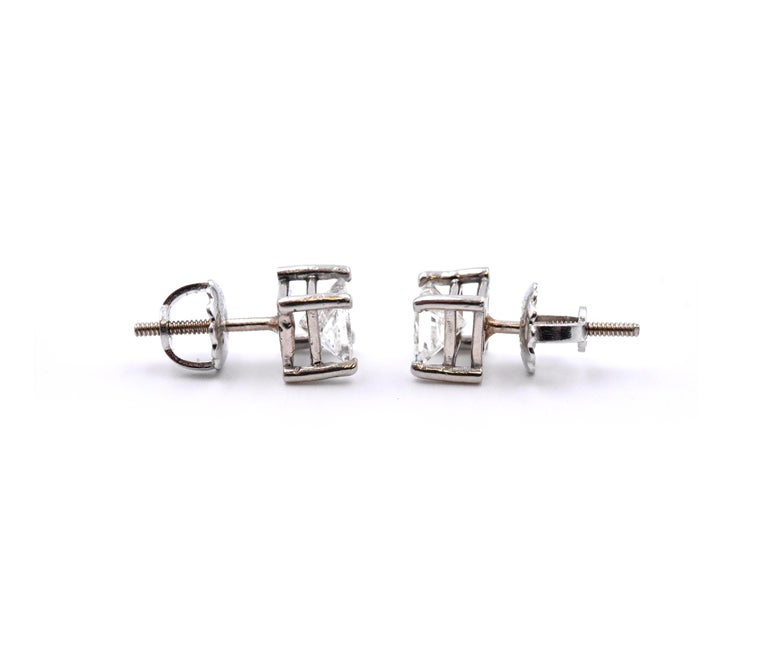 Material: 14k white gold Diamonds: 2 princess cuts = 1.10cttw Color: G-H Clarity: SI1 Dimensions: earrings measure approximately 5.8mm x 5.8mm Fastenings: post with screw backs Weight:  1.42 grams