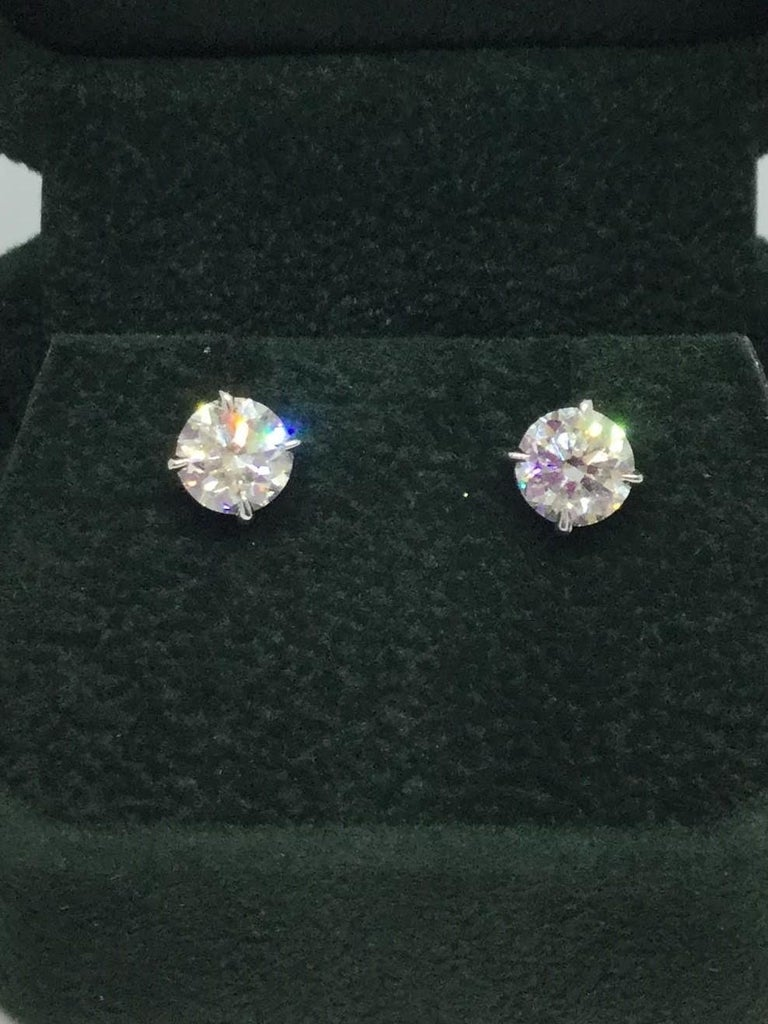 14K white gold diamond studs. Diamonds weigh 2.04 ctw H/SI2. Diamonds are set in a wire basket setting with friction posts.