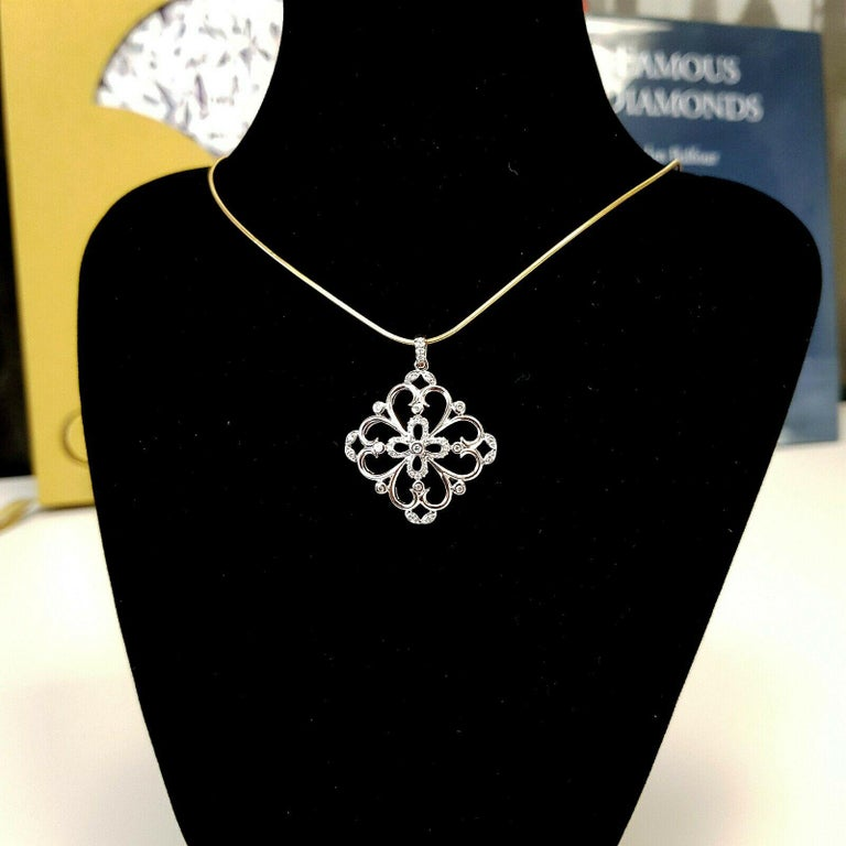Contemporary 14 Karat White Gold Floral Design Pendant with Diamonds with .50 Points For Sale