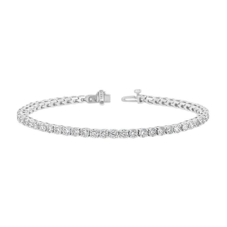 A timeless four prongs diamonds tennis bracelet. Experience the Difference!  Product details:   Center Gemstone Type: NATURAL DIAMOND Center Gemstone Color: WHITE Center Gemstone Shape: ROUND Center Diamond Carat Weight: 5.76 Center Diamond Color: