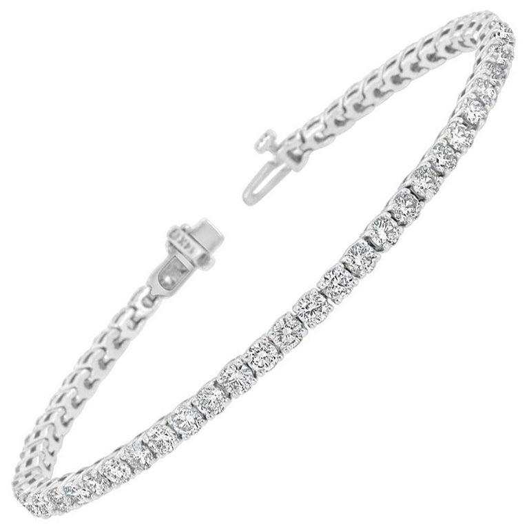 14k White Gold Four Prongs Diamond Tennis Bracelet '5 3/4 Ct .tw' For Sale