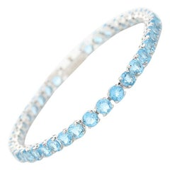 14 Karat White Gold Light Blue Topaz Tennis Line Bracelet