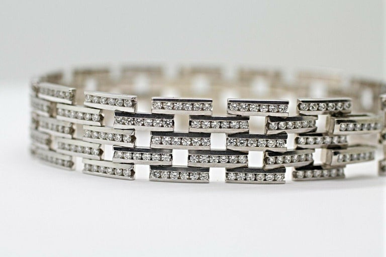 Beautiful 5 row Maillon Panthere diamond bracelet features 450 pieces of round cut diamonds in approximately 4.5 carat total weight in I color and VS2 in clarity. This bracelet crafted in 14K white gold metal, 30.9 grams total weight and 7.5 inches.