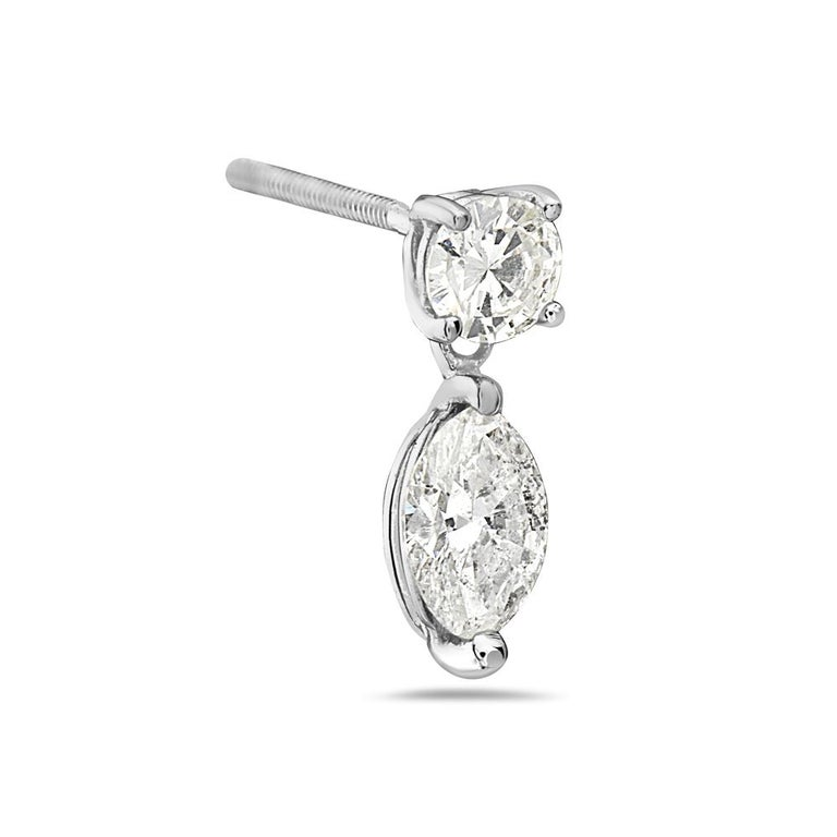 These drop dangle earrings feature 1.05 carats of marquise diamonds set in 14k white gold. Post back for pierced ears. Made in USA.  Viewings available in our NYC showroom by appointment.