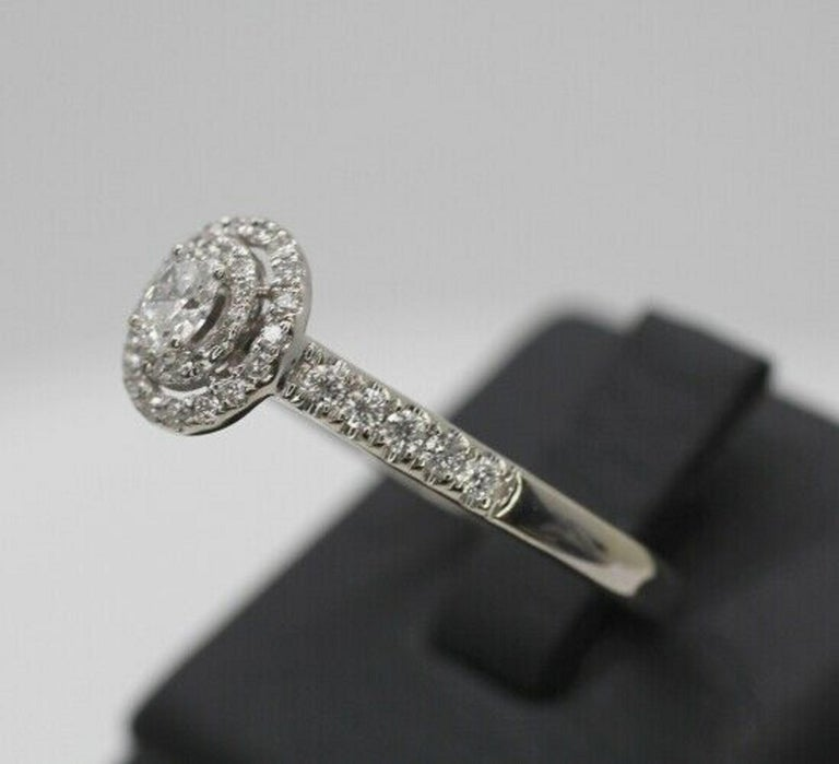 Contemporary 14 Karat White Gold Oval Diamond Halo Ring For Sale