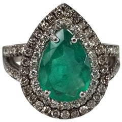 14 Karat White Gold Pear Shape Emerald and Diamond Double Halo Ring