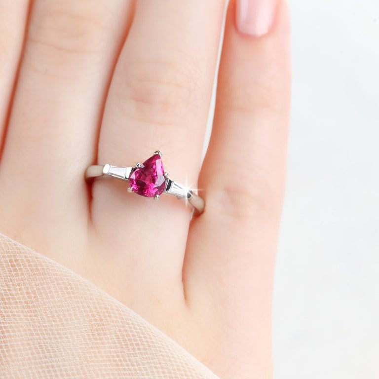 Modern 14 Karat White Gold Pear Shaped Ruby with Baguette Diamonds Ring For Sale