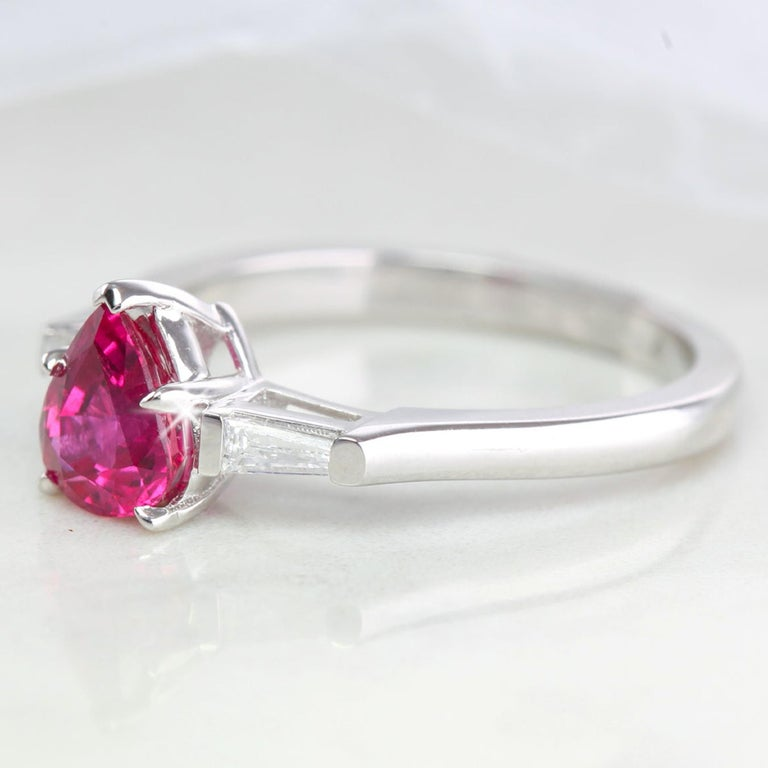 Pear Cut 14 Karat White Gold Pear Shaped Ruby with Baguette Diamonds Ring For Sale
