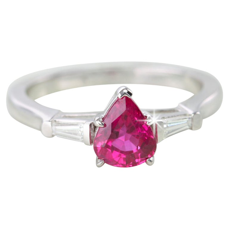 14 Karat White Gold Pear Shaped Ruby with Baguette Diamonds Ring For Sale