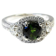14 Karat White Gold Ring with Green Tourmaline in Center with Halo Diamonds