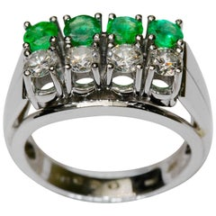 14K white gold ring with round diamonds and emeralds