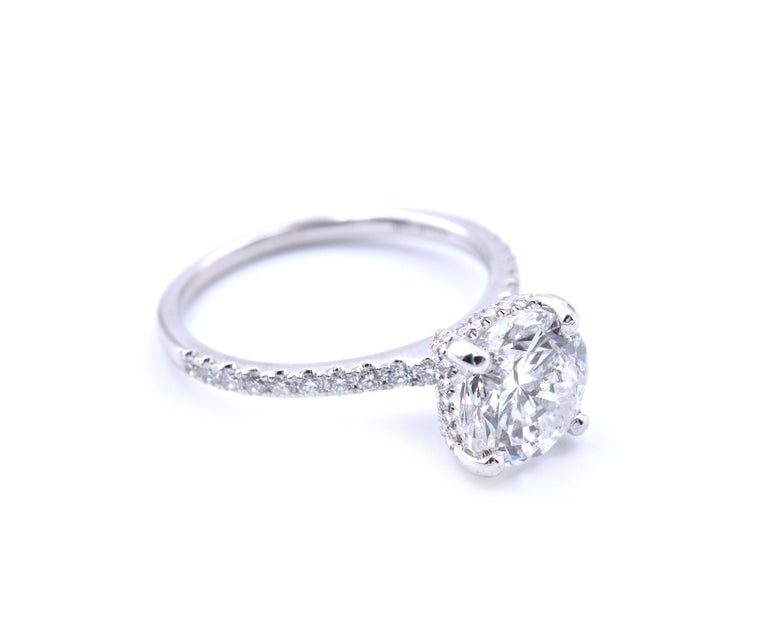 Material: 14k white gold Center Diamond: 1 round brilliant cut = 2.10ct Color: H Clarity: I1 Mounting Diamonds: 60 round brilliant cuts = 1.00cttw Color: G Clarity: VS2 Ring Size: 7 (please allow two additional shipping days for sizing