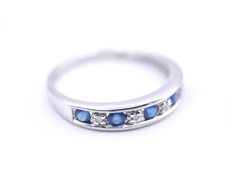 Designer: custom design Material: 14k white gold Sapphire: 5 sapphire round cut= .25cttw Diamonds: 4 round cut= .02cttw Color: G Clarity: VS Ring size: 7 (please allow two additional shipping days for sizing requests) Dimensions: ring is 3.95mm