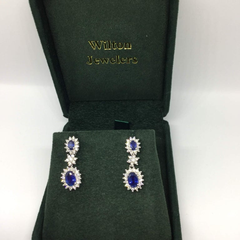 14K white gold sapphire and diamond earrings. The sapphires weigh approx 2.50 ctw and are medium blue in color. The diamonds weigh approx 1.30 ctw. The stones are prong set. The posts are friction.